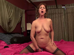 Horny Mature Taking Off Her Black Lingerie And Toying