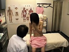 Sweet Japanese girl has a masseur fingering her hairy cunt