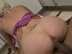 Blonde with curvy ass gets fucked in the kitchen.