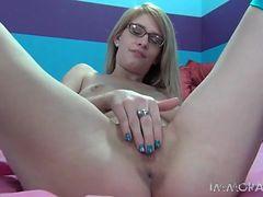 Cute solo girl in glasses vibrates her vagina