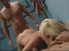 Skinny blonde gets fucked by two guys in a threesome