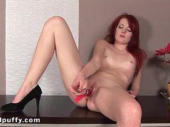 Sexy masturbating redhead pees on the floor